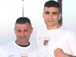 L'atleta Christian Cicala con il tecnico Alberto Servirdei