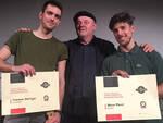 Giordano Sangiorgi del Mei premia per Artistation Marco Placci e Tommaso Dall'Arno